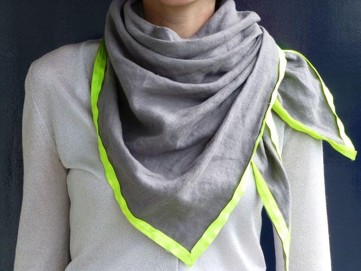 // Grey wrap shawl with neon yellow rim.