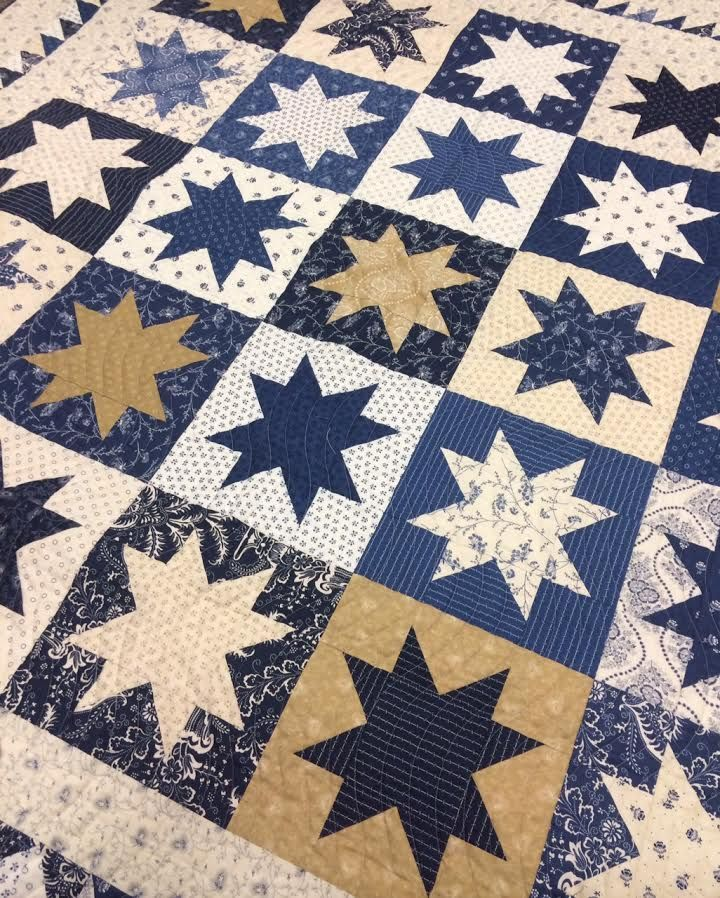 Spinning Stars Quilt. This quilt is available for sale at www.hollyhillquiltshoppe.com 2016.