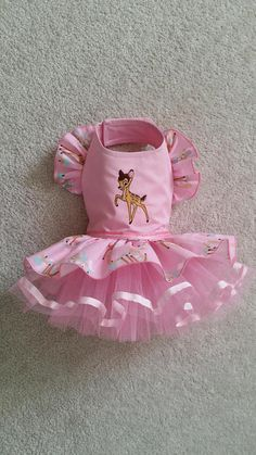 Description Practical and fashionable excellent quality made with attention to detail Limited edition. Bambi inspired Dress, velcro closure. Please note this is very strong velcro. Excellent Quality Dog clothes :) Teddy Face Items are tailored for small dog breeds & puppies .