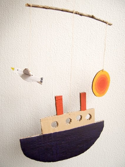 Boat and bird mobile, made from a branch, cardboard, string and paint. I love it.