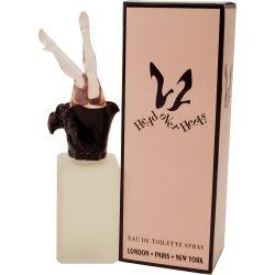 Ultima 2 Head over Heals. Dit parfum uit 1994 in het opvallende flesje met de vrouwenbenen op de dop is bloemig, fruitig en zoet, met meloen, perzik, pruim en bloemensoorten als belangrijkste geurnoten