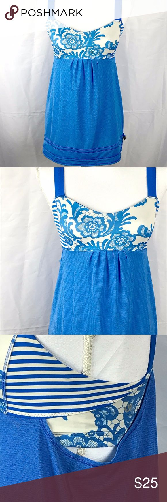 "Lululemon Size 6 Floral Stripe Brand: Lululemon  Type of Clothing:  Shirt  Condition: Pre-Owned  Color: Blue and White  Size:  6  Measurements (Approximate. Taken Flat)  Across Chest: 12""  Length: 20""  Additional Details: Pre-Owned Lululemon Blue and White Floral Print Size 6 Sports Bra Yoga Shirt in great condition lululemon athletica Tops Tank Tops"