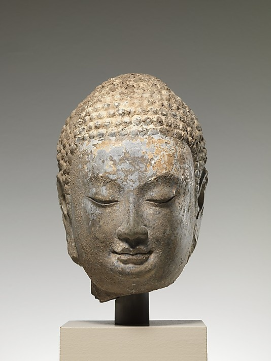 Head of a Buddha    Period:      Northern Qi dynasty (550–577)  Date:      mid-6th century  Culture:      China  Medium:      Limestone with traces of pigment and gilding