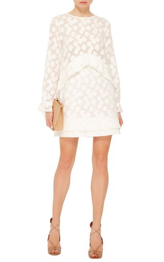 This **Tanya Taylor** long sleeve dress is delicately crafted with two tiers finished ruffled hems and a floral lace motif.