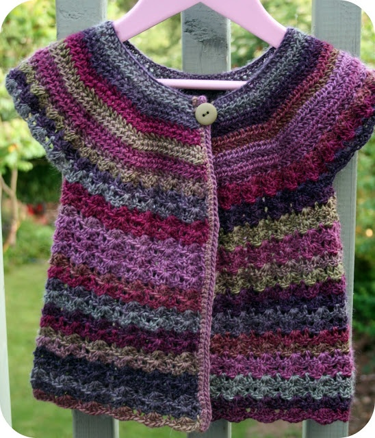 Multicolored cardigan. I want to make something with this yarn.