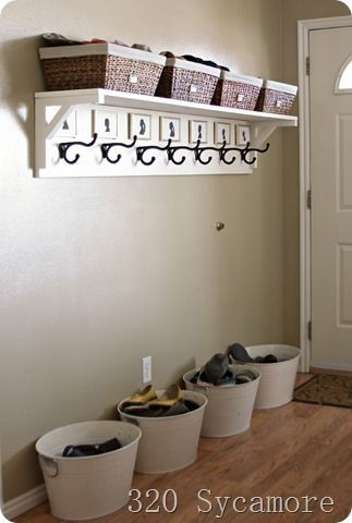 Entryway idea. I LOVE the shelf with hangers and baskets on top for less-often used things. (More ideas listed on this site)