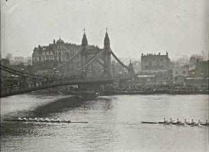 Hammersmith Bridge with Oxford & Cambridge Boat Race, 1928. Dixon, Appleby & Thorne's bridge was built in 1887.