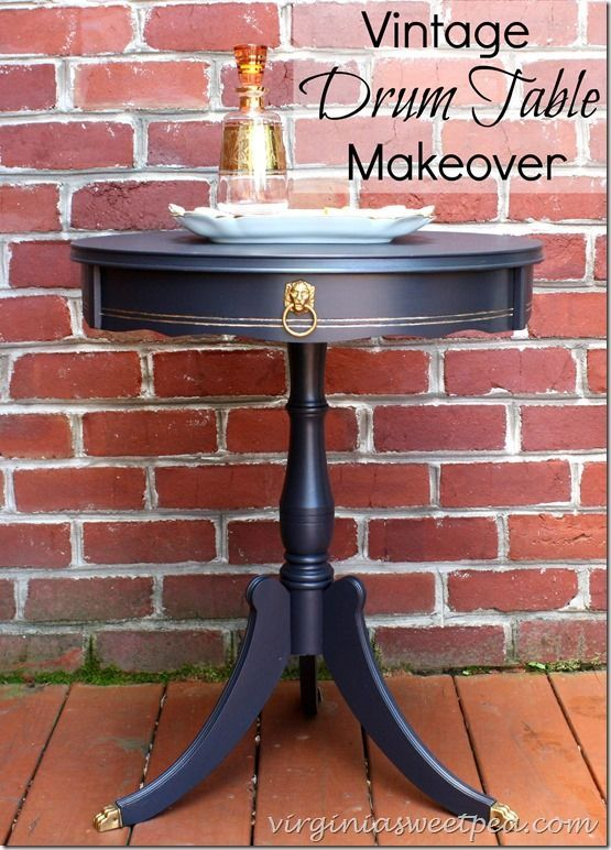 A vintage drum table that was in not-so-great shape got a makeover with paint. This table looks great now! virginiasweetpea.com