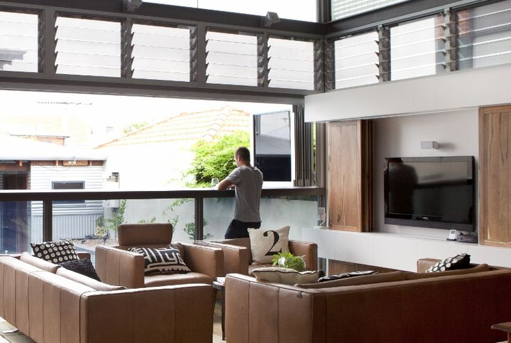 The Salvaged Timber Home by Twinkle & Whistle (for Scoop Magazine) - Living Room: bifold windows opening onto the outdoor area - Craig Steere Architects