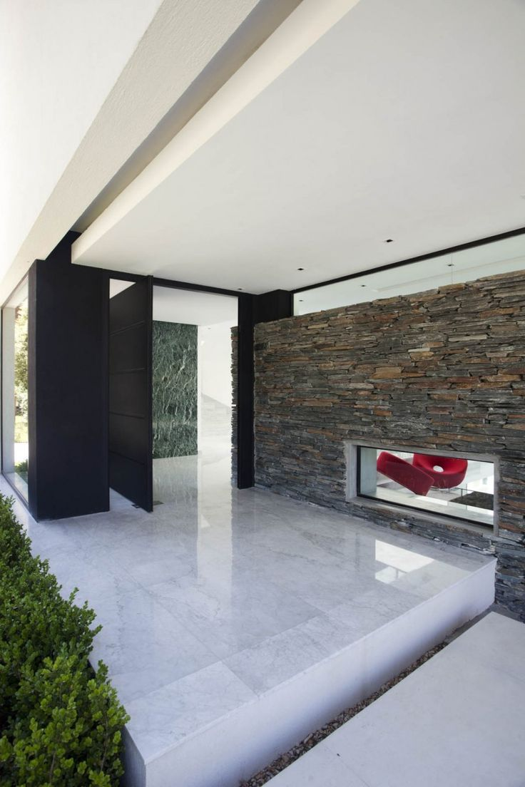 Interior Detail With Pivoting Door At The Carrara House In Pilar, Argentina  By Andres Remy