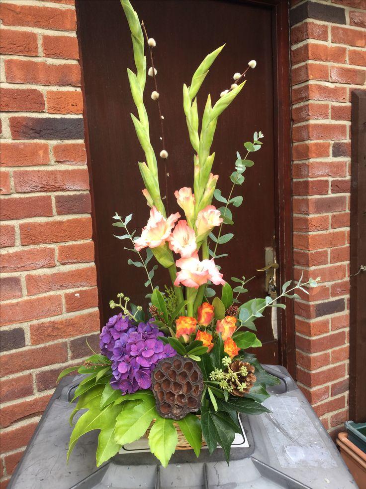 Gladioli, roses and hydrangea.
