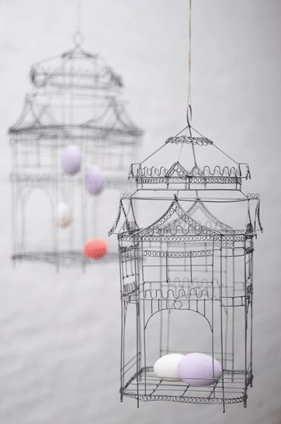 Beautiful, delicate wire bird cages. I want.