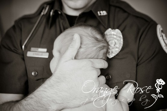 Police Officer with Newborn Baby