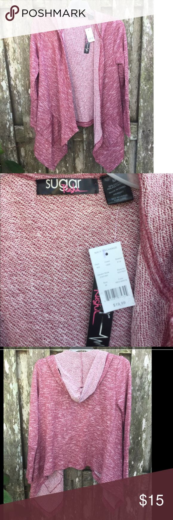 Sugar rush textured jacket New with tags!! This pink jacket is thick and warm. The front is longer than the back. It has pockets and a hood. There is not a draw string. The jacket was purchased for $20 at the navy exchange, but probably cost more anywhere else, which is why I'm asking for a bit more. Please negotiate though. This is just my starting price! Jackets & Coats