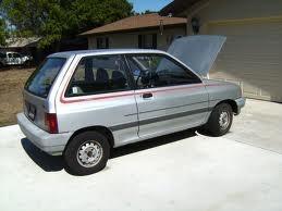 A Silver Ford Festiva