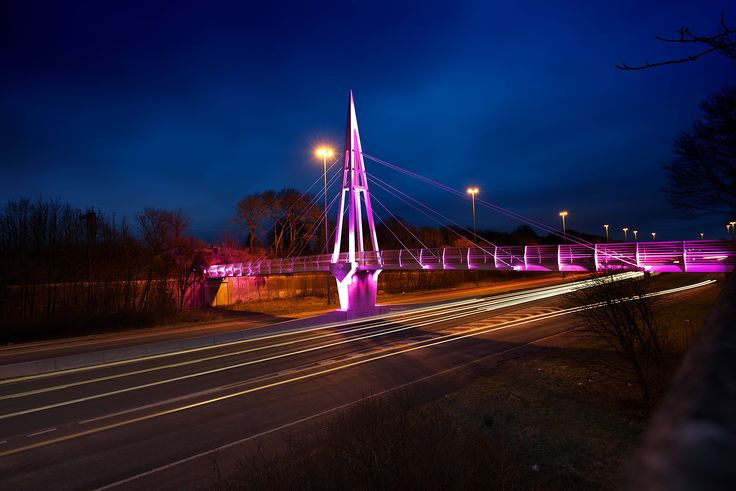 The Greystone footbridge lit in pink for Mother's Day 2017