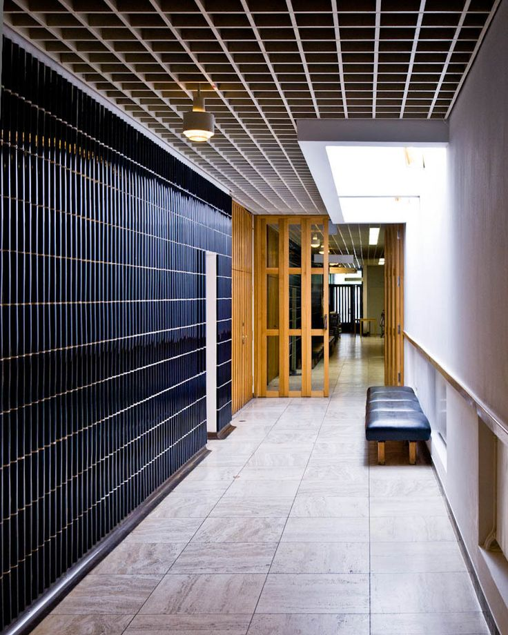 ad-classics-wolfsburg-cultural-center-alvar-aalto_alvar-aalto-germany-wolfsburg-cultural-center-01-samuel-ludwig [black wall tiles: idea for bathroom]