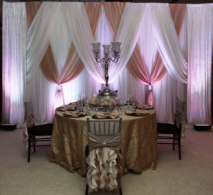 Love the jeweled centerpieces...jewels jewels jewels give me more! #Pellazio I would prefer gold chivarri chairs and the bottom table cloth in blush.