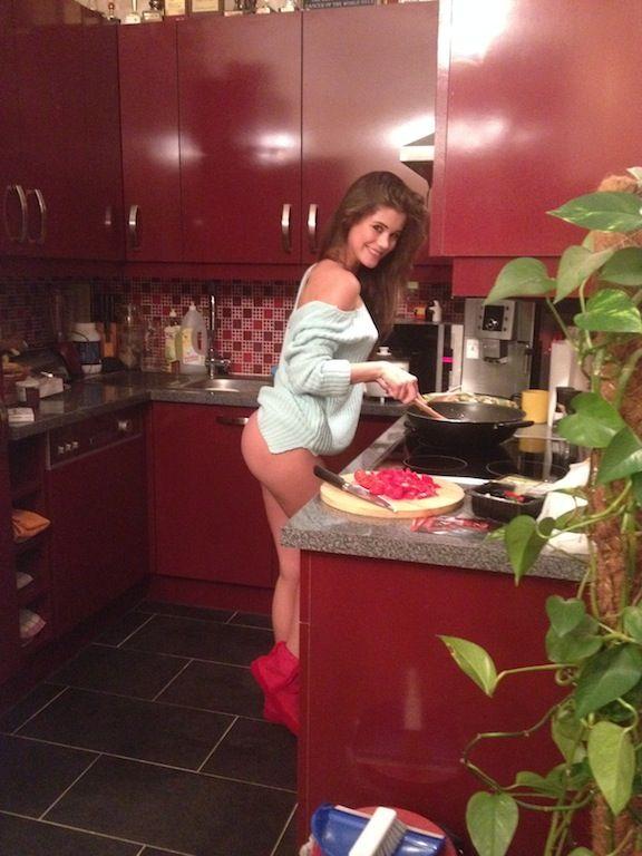 Marketa Stroblova cooking in the kitchen in Europe.
