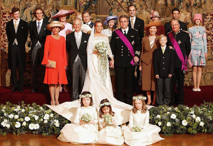 Claire Coombs and her husband Prince Laurent pose for the official family photo with their parents at the Royal Palace in Brussels, 12 Apr 2003.