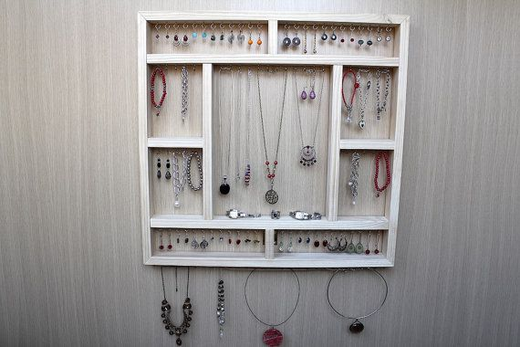 This beautiful jewellery organiser is supplied in raw timber for you to stain or paint and comes ready to hang with nail pins for plasterboard