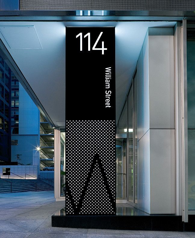 Providing a more defined presence for the building at street level, the main location sign is a three meter high light box wrapped with perforated anodized aluminium panels.