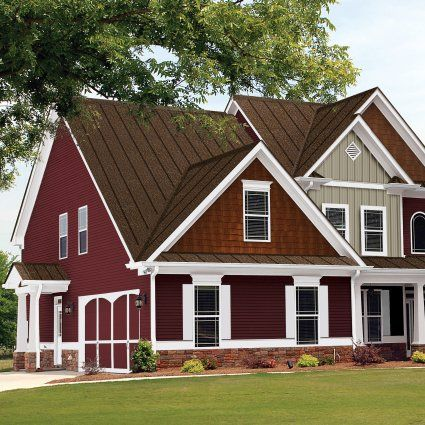 Houses with brown metal roof steel roofing metal for Red brick house with metal roof