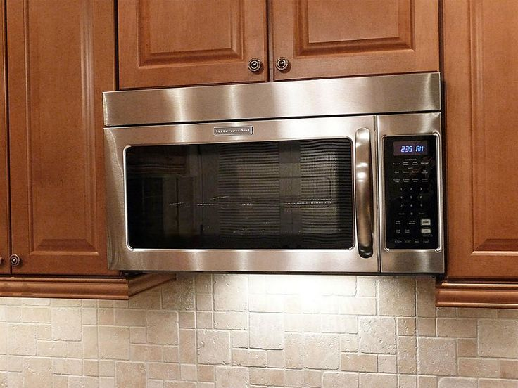 Classic Kitchen Ideas with Stainless Steel Cabinet Kitchen Aid Over Range Microwave, 1000 Watts Cooking Power, and Dark Brown Hardwood Kitchen Cabinet Design