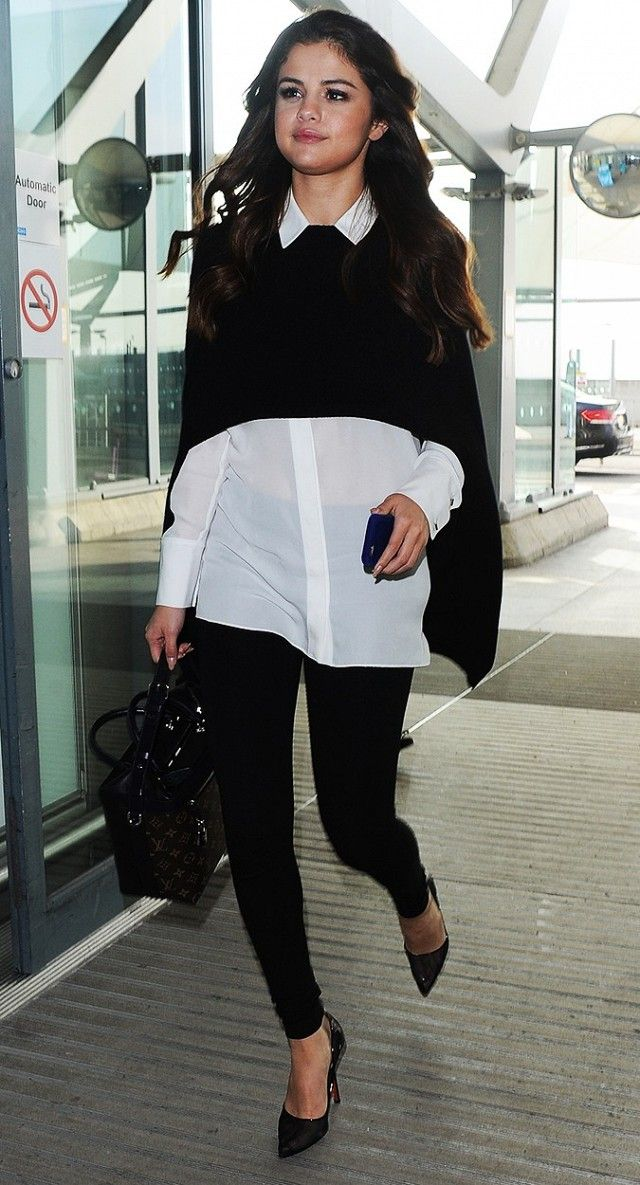 Selena Gomez wears an Alice + Olivia Lolita button down under a black cape with Front Zip leggings and black pumps