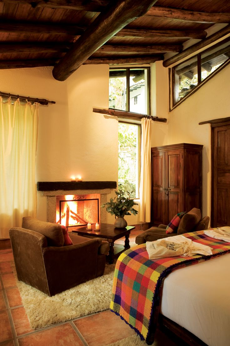Whitewashed pueblo casitas cluster together in a cloud forest at the foot of Machu Picchu. After an expedition to the ruins, cuddle up in a soft alpaca blanket and gaze into the crackling fire—there's one in every room, at the Inkaterra Machu Picchu Pueblo Hotel.