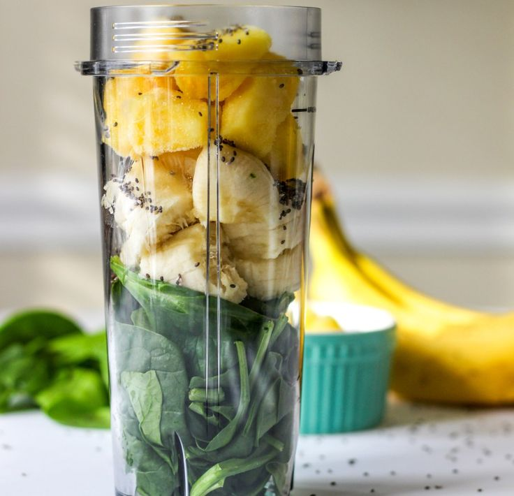 Delicious and filling detox green smoothie with chia seeds, spinach, banana, pineapple, and almond milk. A healthy meal replacement!