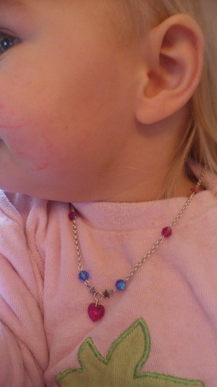 My babygirl's sterling silver and Swarovski Elements Fuchsia heart pendant