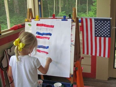 Try this flag inspired easel painting for the Fourth of July from Teach Preschool #FourthOfJuly #IndependenceDay
