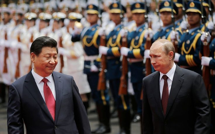 In a symbolic blow to U.S. global financial hegemony, Russia and China took a small step toward undercutting the domination of the U.S. dollar as the international reserve currency