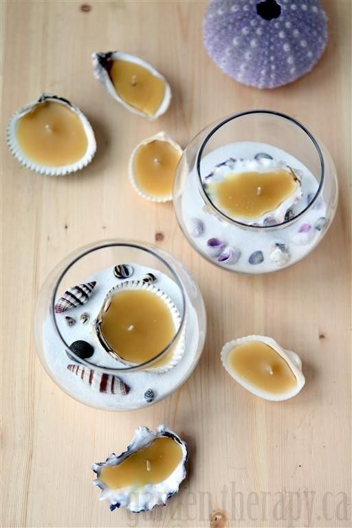 Oyster Shell Tea Light Candle DIY - get some wicks and melt beeswax into oyster and clam shells. This would be good for a beach event or wedding. They are easy to make with these instructions.