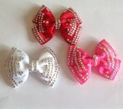 <p>Beautiful small rhinestone hair bow.<br />Handmade with the best quality crystals for a super sparkle.<br />Comes in a variety of colours and can also be made in custom colours to match your costume.</p>