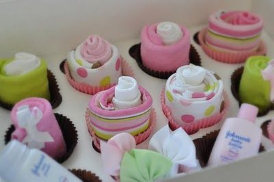 Sock Cupcakes. Adorable baby shower gift- made from baby socks, wash cloths, baby products and hair bows. So cute!
