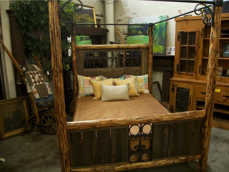 With some reclaimed wood and iron, the Dawgs made this craftsman-style canopy bed designed by Mike and his daughter, Grace.