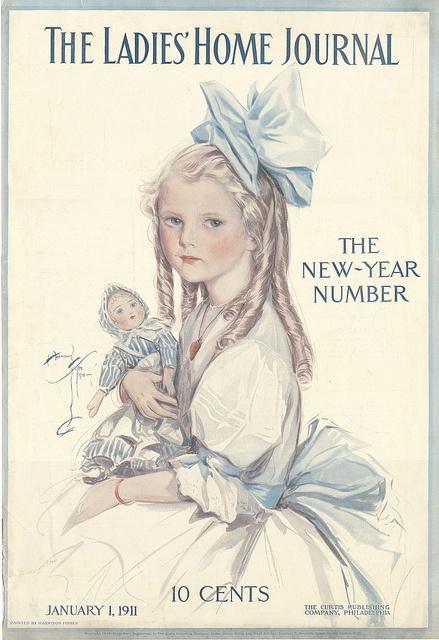 Jan 1, 1911, Ladies Home Journal - looks like a Babyland Rag doll she's holding.