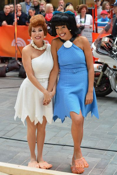 "Kathie Lee Gifford Photos Photos - Kathie Lee Gifford (L) and Hoda Kotb, dressed as Flintstone characters Wilma Flintstone and Betty Rubble, attend NBC's ""Today"" Halloween 2013 in Rockefeller Plaza on October 31, 2013 in New York City. - 'Today' Hosts Dress Up for Halloween"