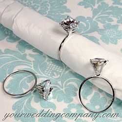 Diamond Ring Napkin Holders - These silver napkin rings feature a sparkling solitaire engagement ring design - bridal showers - reception tables - anniversary tables - Tiffany themed events - via www.yourweddingcompany.com