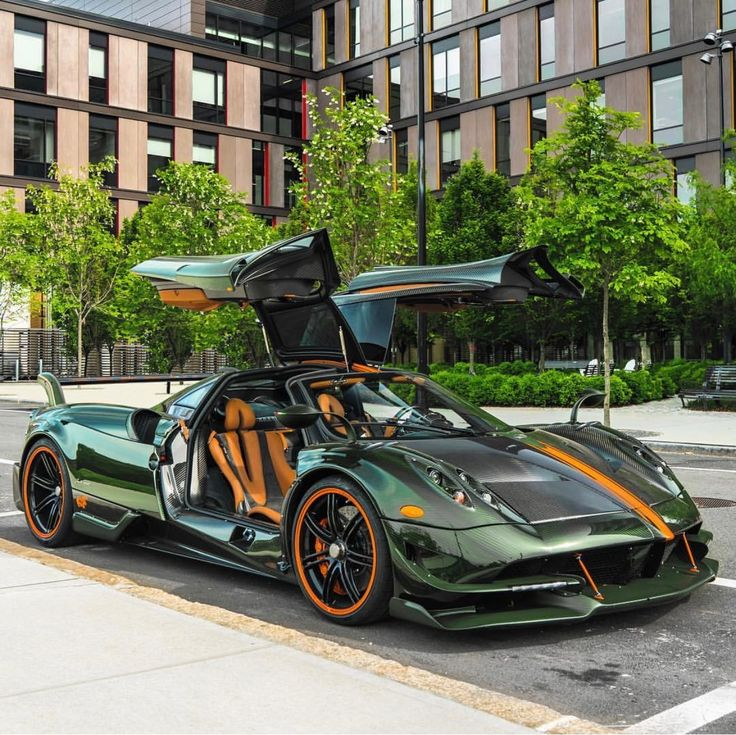 Pagani Huayra BC made out of Green & Gray exposed carbon fiber w/ Orange accents  Photo taken by: @carsandtrees on Instagram   Owned by: @gregb.23 on Instagram