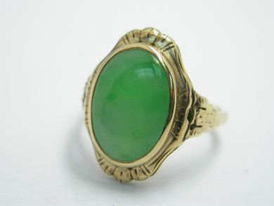 Try on this 14 karat yellow gold vintage ring. One cabochon jadeite jade (4.80 carats: natural green colour with brighter tones).