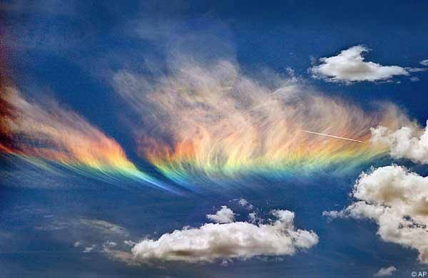 My girls used to call these 'cloud rainbows', and another name is 'sun dogs'.  I've heard they are the reflection of the sun's rays through ice crystals.  I'll have to learn more about this beautiful phenomena.