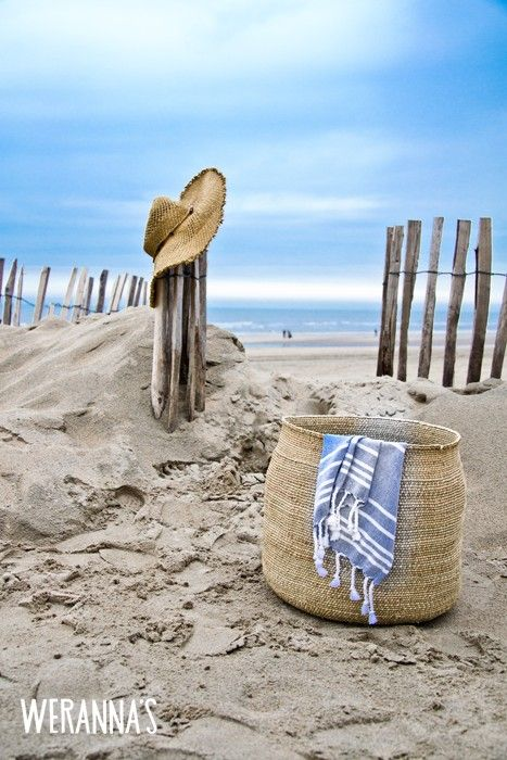 ahh a beach hat, a basket, Turkish stripe beach towel, a blue sky and a path down to the beach...purrrfect