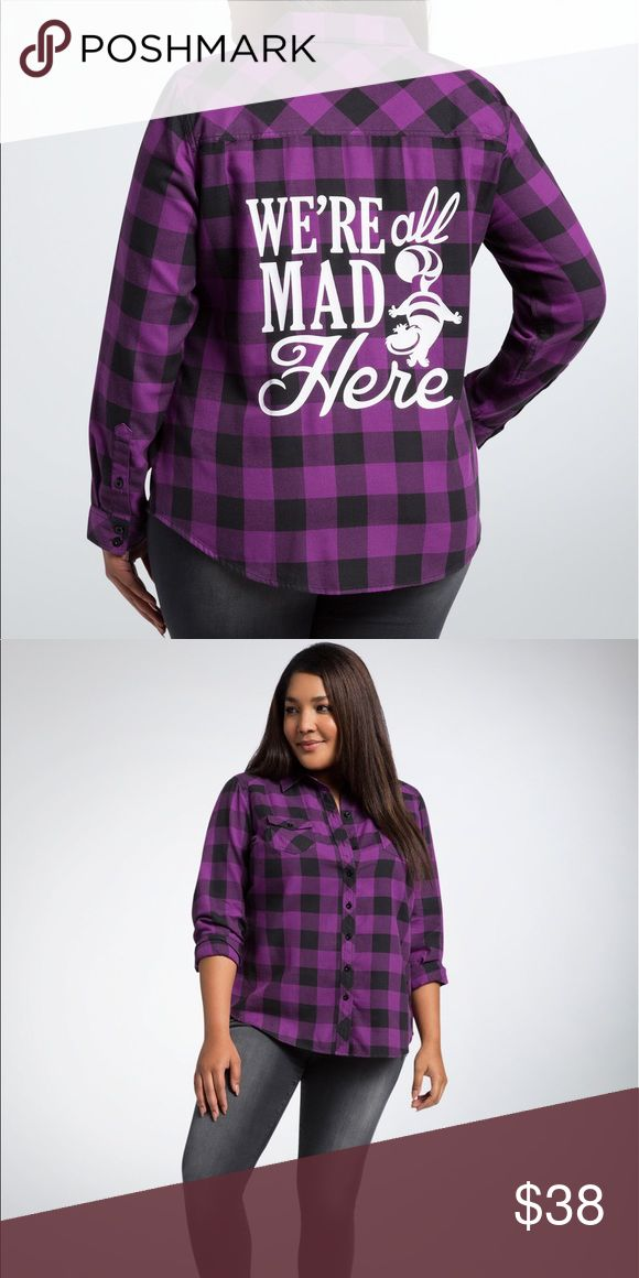 """Women's Torrid Cheshire Plaid Shirt We're not crazy, our reality is just different than yours with this plaid shirt! While the black and purple plaid checks out up front (button front, breast pockets, button sleeves), the Cheshire Cat sends out a reminder on the back with """"we're all made here.""""  Model is 5'10"""", size 1   *   Size 1 measures 30 1/4"""" from shoulder  *   Cotton/polyester  *   Wash cold, dry low  *   Imported plus size shirt torrid Tops Button Down Shirts"""