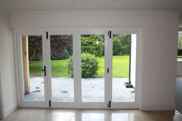 Privett Timber Windows - 4 Leaf fully glazed hardwood timber bifold doors in Limpsfield, near Oxted, Surrey