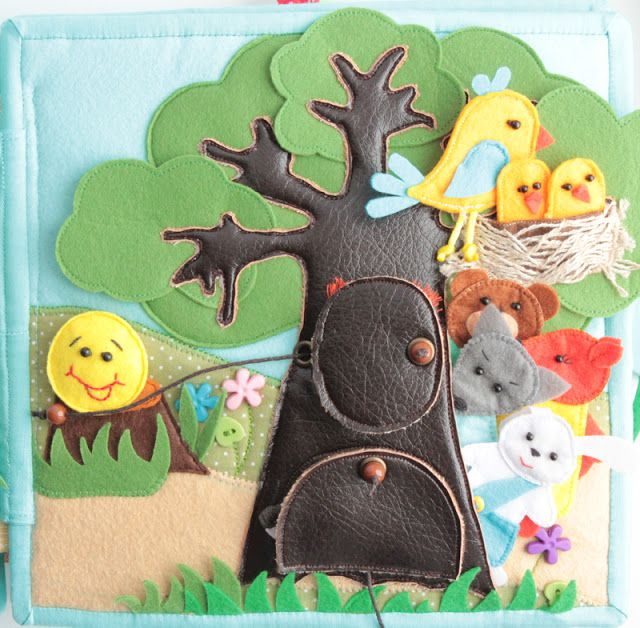 Quiet book page with little birds and animals in a tree - made from leather! So cute. By HandmadeByMom Blog