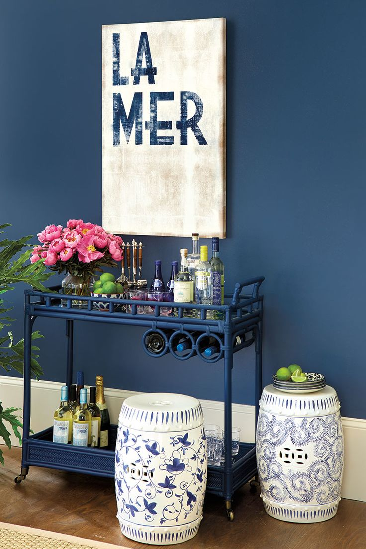 Chinoiserie-inspired garden seats, bar cart and blue walls