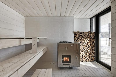 A sauna in a Finnish holiday cabin. Huge windows and nothing but snow and forest outside. Perfection.